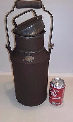 """Vintage """"JCB"""" can with lid and swing handle"""
