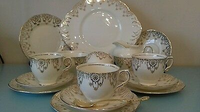 Beautiful 15pc tea set cream and gold and red