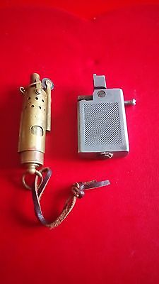 Trench lighter plus one other lighter for spares or repair.