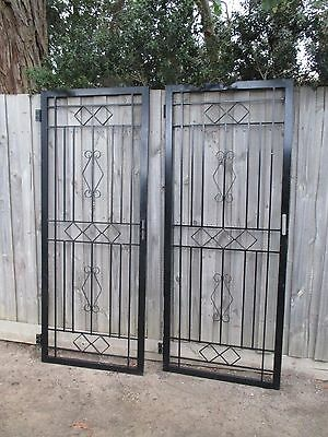 2 wrought iron screen doors frames. Garden trellis frames.