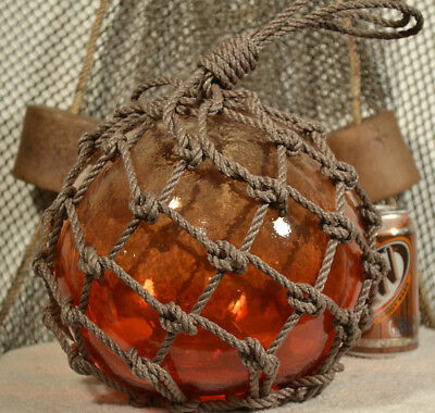 Vintage Glass Fishing Float In Red With An Amber Tint