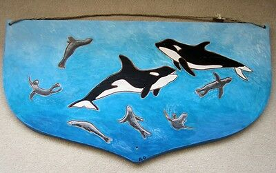 Killer whales (Orcas) & sea lions carved artwork on boat transom sea life craft