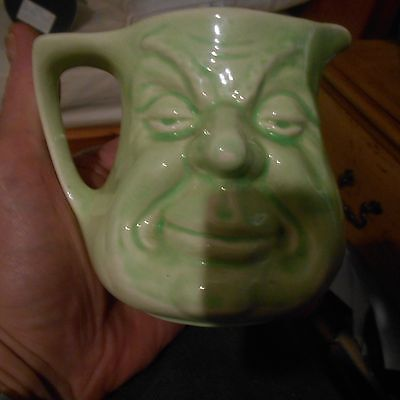 green pottery before/ after jug
