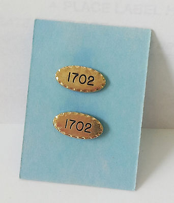 Matched set of gold oval hat pins with 1702