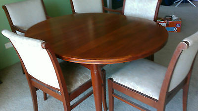 Parker extendable solid timber  dining table and 5 chairs - possibly Mahogony