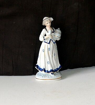 Lady with bird cadge. Price reduced from$13 to $ 6.66.