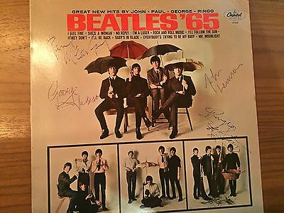 """Beatles 65"" signed album by all 4 members"