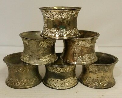 6 vintage unmarked silver plate napkin rings