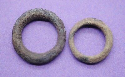 Two pieces of Ancient Celtic bronze ring money 200 BC