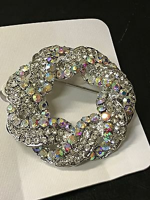 Beautiful round bridal silver brooch with crystal rhinestones