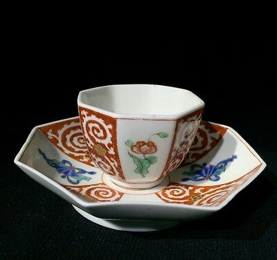 Chelsea teabowl and saucer with kakiemon panel decoration, raised/ red anchor pe
