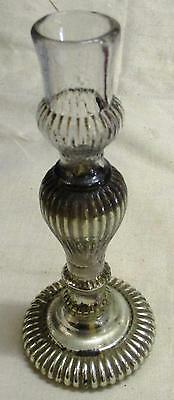 An antique French mercury glass candlestick