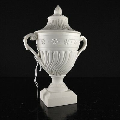 Mennecy unglazed porcelain classical covered urn, c.1765