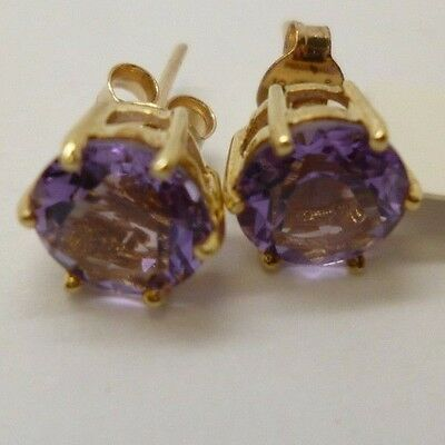 9ct yellow gold beautiful round Amethyst claw set stud earrings