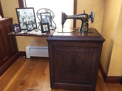 Vintage Singer Red Eye Treadle Sewing Machine Model No. 66 G9662763 with Cabinet