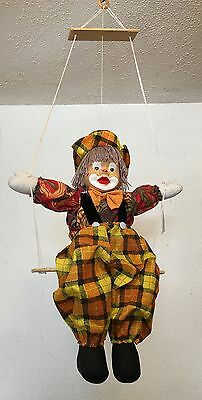 Clown Doll on Swing with porcelain face 19""