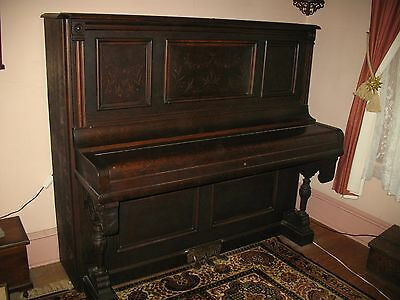 Vintage antique upright piano with original finish oak case