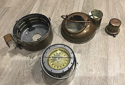 antique ship compass with oil burner