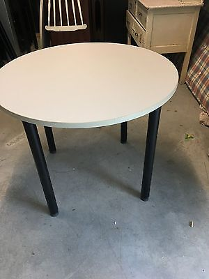 small grey round office tables