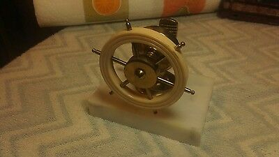 Vintage nutcacker / Brass & Bakelite on Marble / Captains Ship Wheel