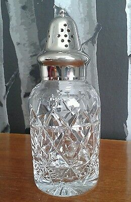 Beautiful vintage cut glass and silver plate sugar shaker.