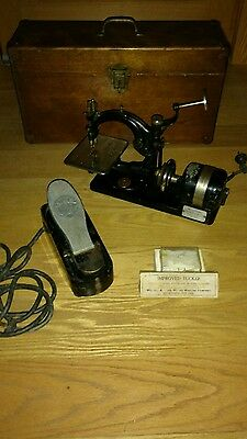 antique Wilcox & Gibbs sewing machine motorized with foot pedal case and more