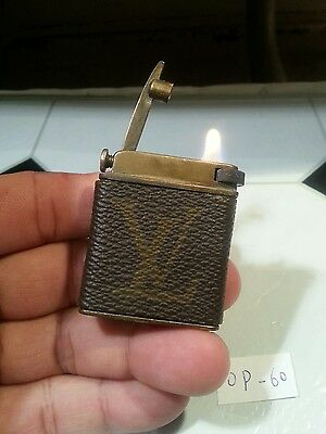 Old petrol lighter OP60 ~ LV decorated leather wrapped  brass,  serviced & grte