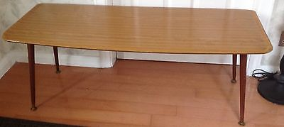 Mid century coffee table with dansette legs.  1950s. Danish Ercol style.