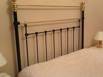 antique cast iron and brass double bed