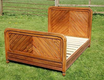 A LATE 19th CENTURY FRENCH PITCH PINE DOUBLE BED WITH BASE