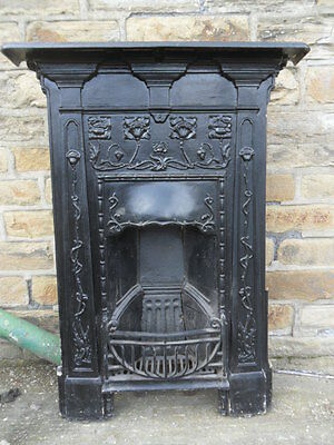 old arts & crafts cast iron fireplace antique iron fire surround  side damaged ?