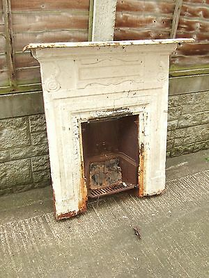 Victorian cast iron fireplace with surround