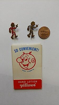 Two different Reddy Kilowatt pin pins and hand lotion pillow