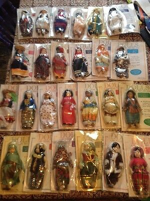 Collectable Porcelain Dolls of the World  in National Costume with magazines lot