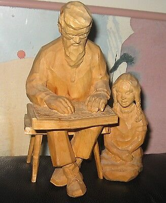 Wood carved man and girl, signed & dated, excellent craftsmanship