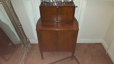 antique 1930s wooden dining room unit.