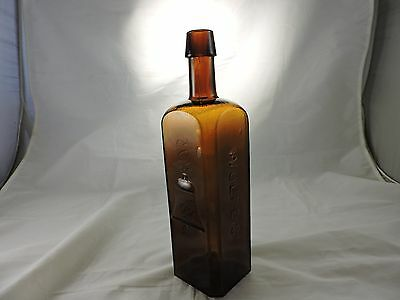 Wolfe's Bell Schnapps Golden Amber Color