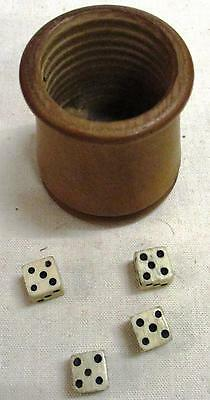 An antique turned treen dice shaker with 4 cow bone dice