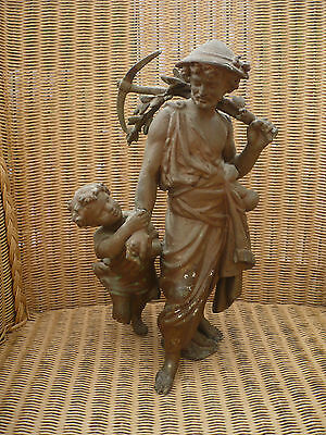 """Antique spelter figure of Roman farmer with child hanging onto his arm 12"""" high"""