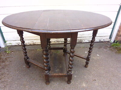 Antique Compact Solid Oak Drop Leaf Twisted Gate Leg Oval Table