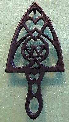 Antique Cast Iron Trivet, Winchester Arms