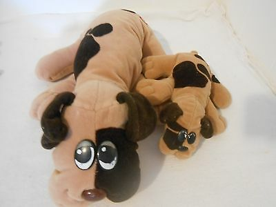 2 Pound Puppies Large And Small Brown