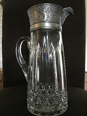 antique glass pitcher with ornate collar