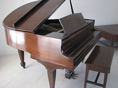 Antique walnut apartment size baby grand piano