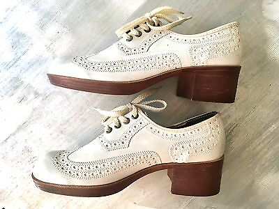 "vintage wing tips white leather 2"" heel, rubber sole, very 70s"