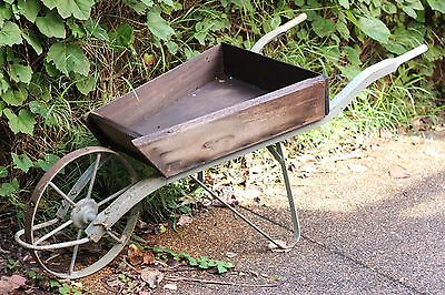 Antique vintage collectable steel and wood wheel barrow garden pot display