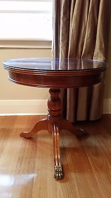 Antique reproduction hall table with brass lion feet