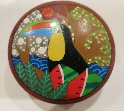 A vintage Cost Rican wooden trinket box with toucan design