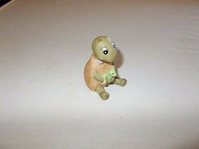 Miniature Porcelain Turtle figurine holding little green worm Collectible Animal
