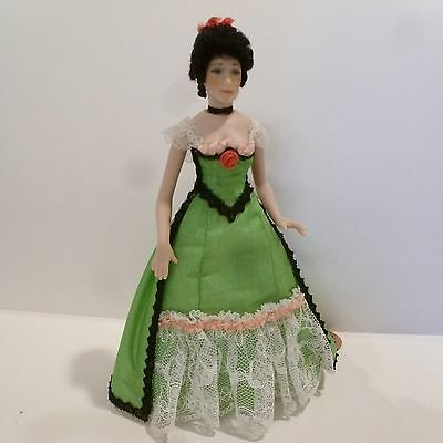 Miniature Lady Doll Wearing Green Dress With Black & White  Lace